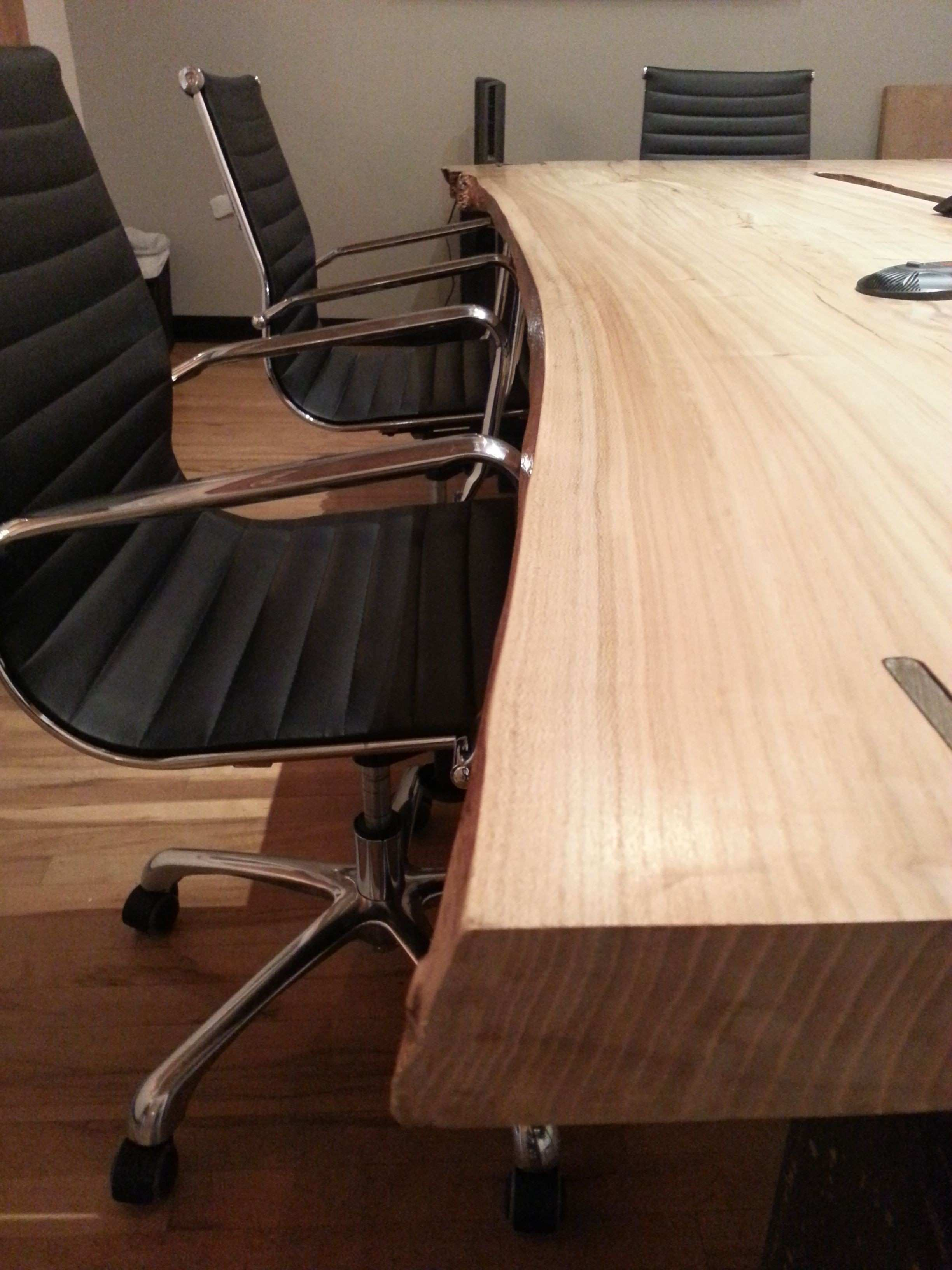 Elm conference table with hidden cable tray and wax finished steel