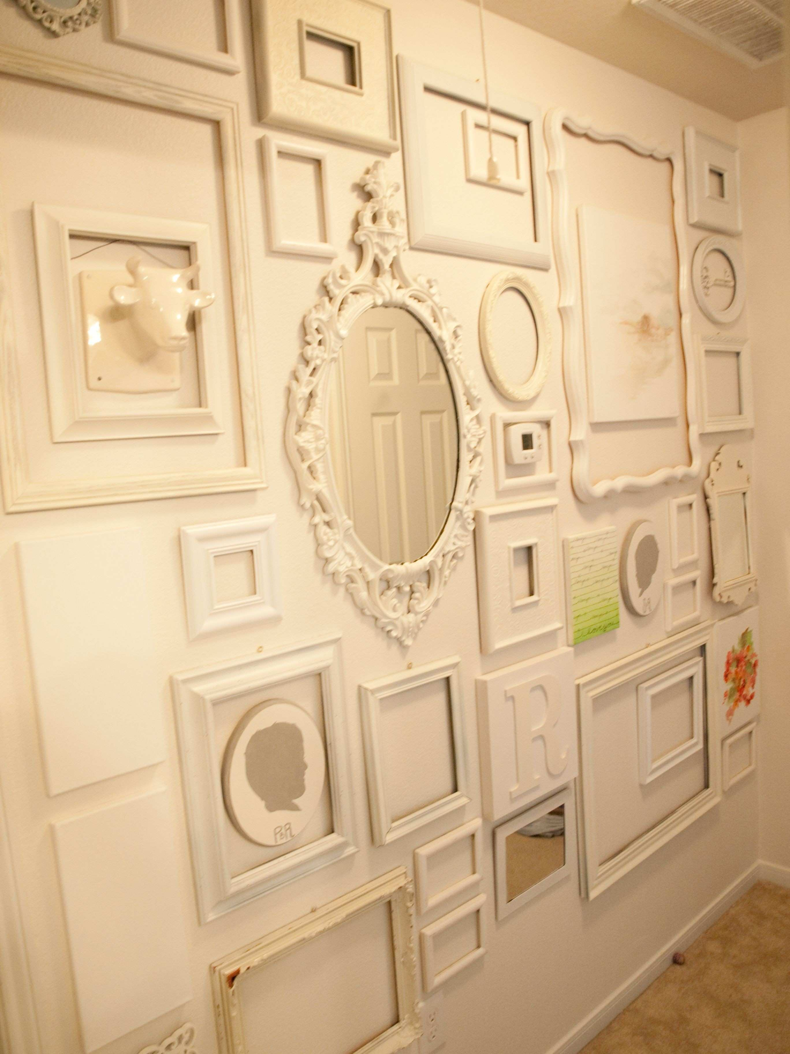 Do something like this but in red frames with the tan wall in the