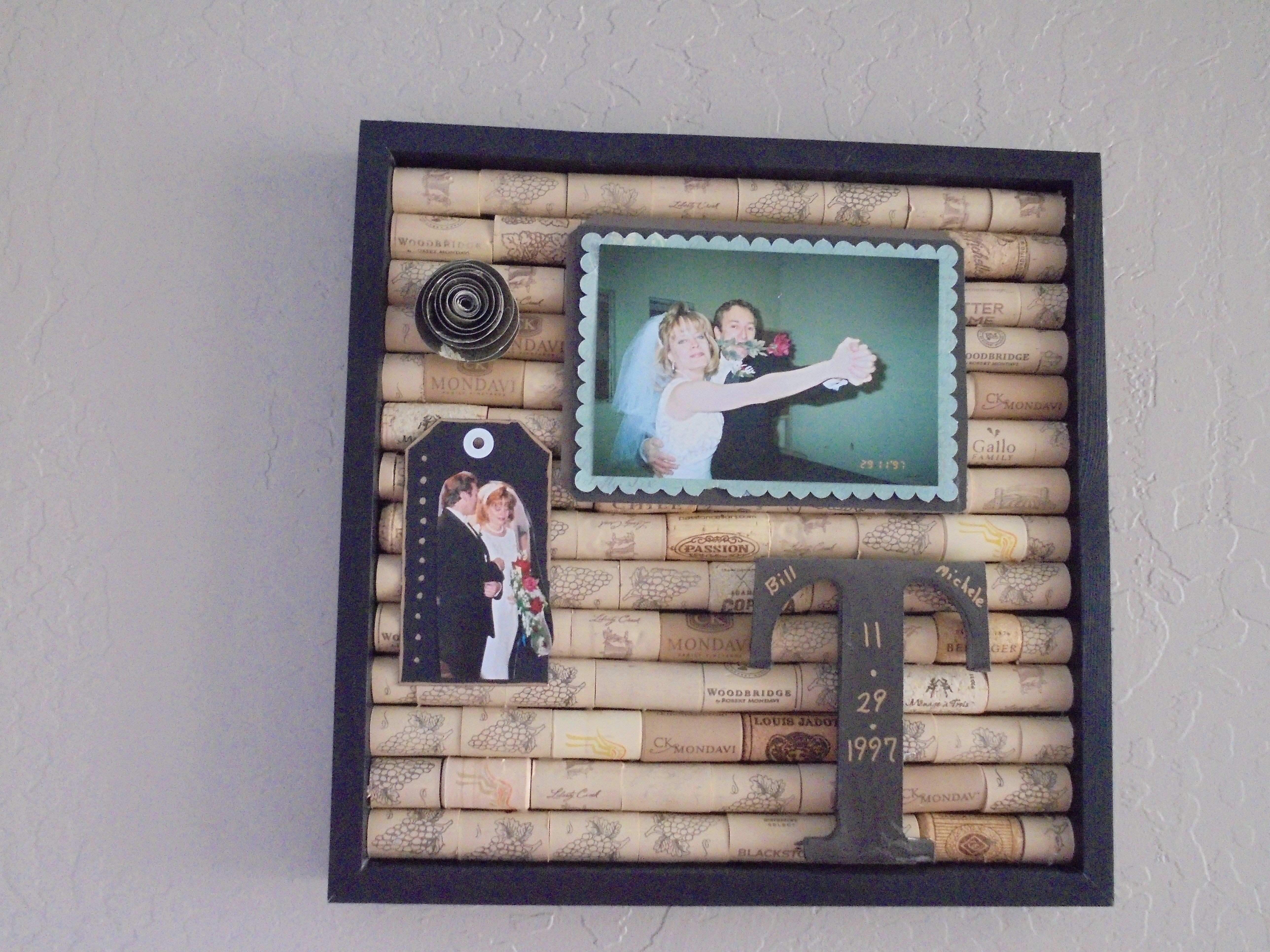 I filled a shadow box with wine corks as a background to display a