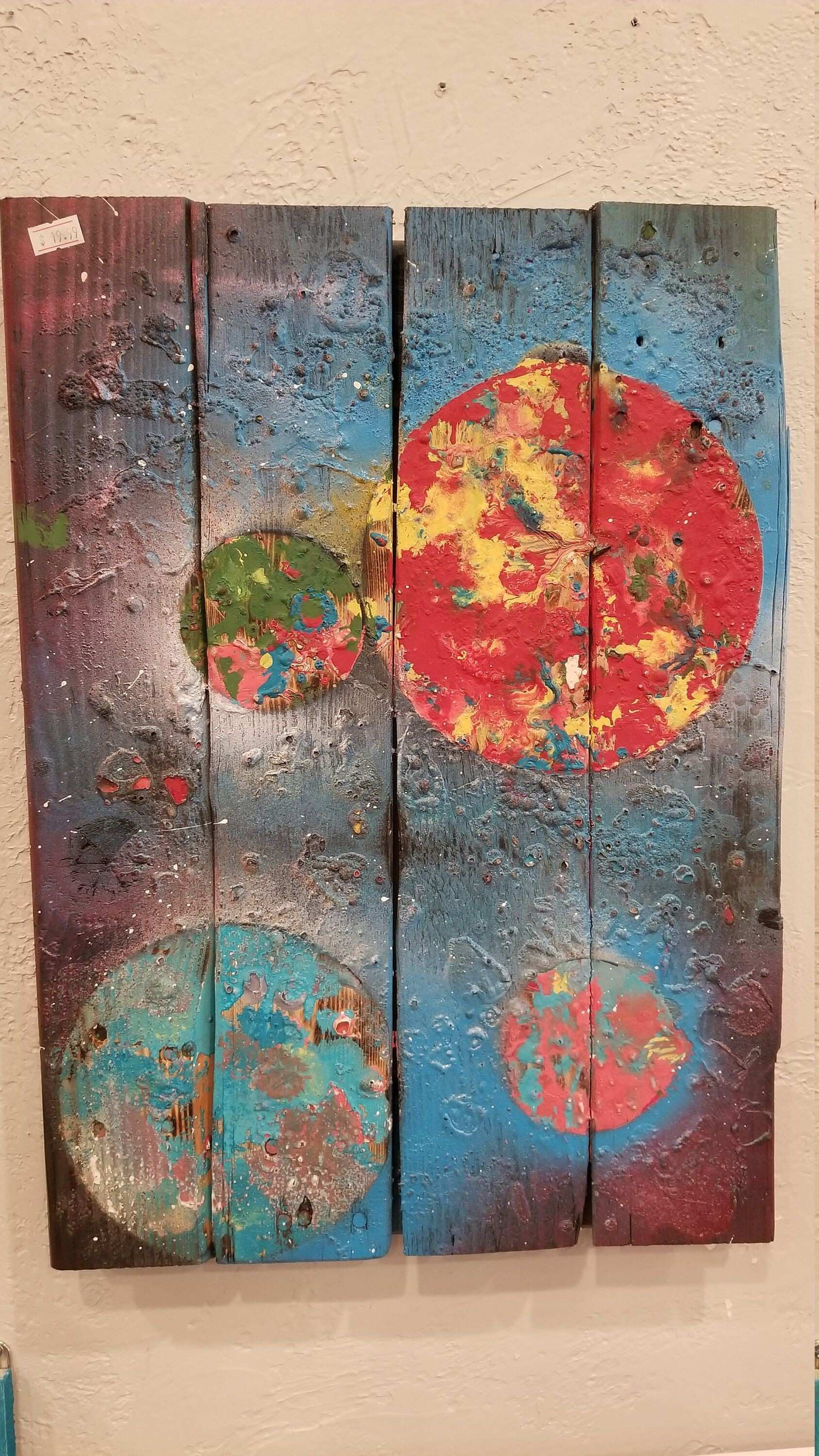 Rustic chalk painted space scene on pallet wood
