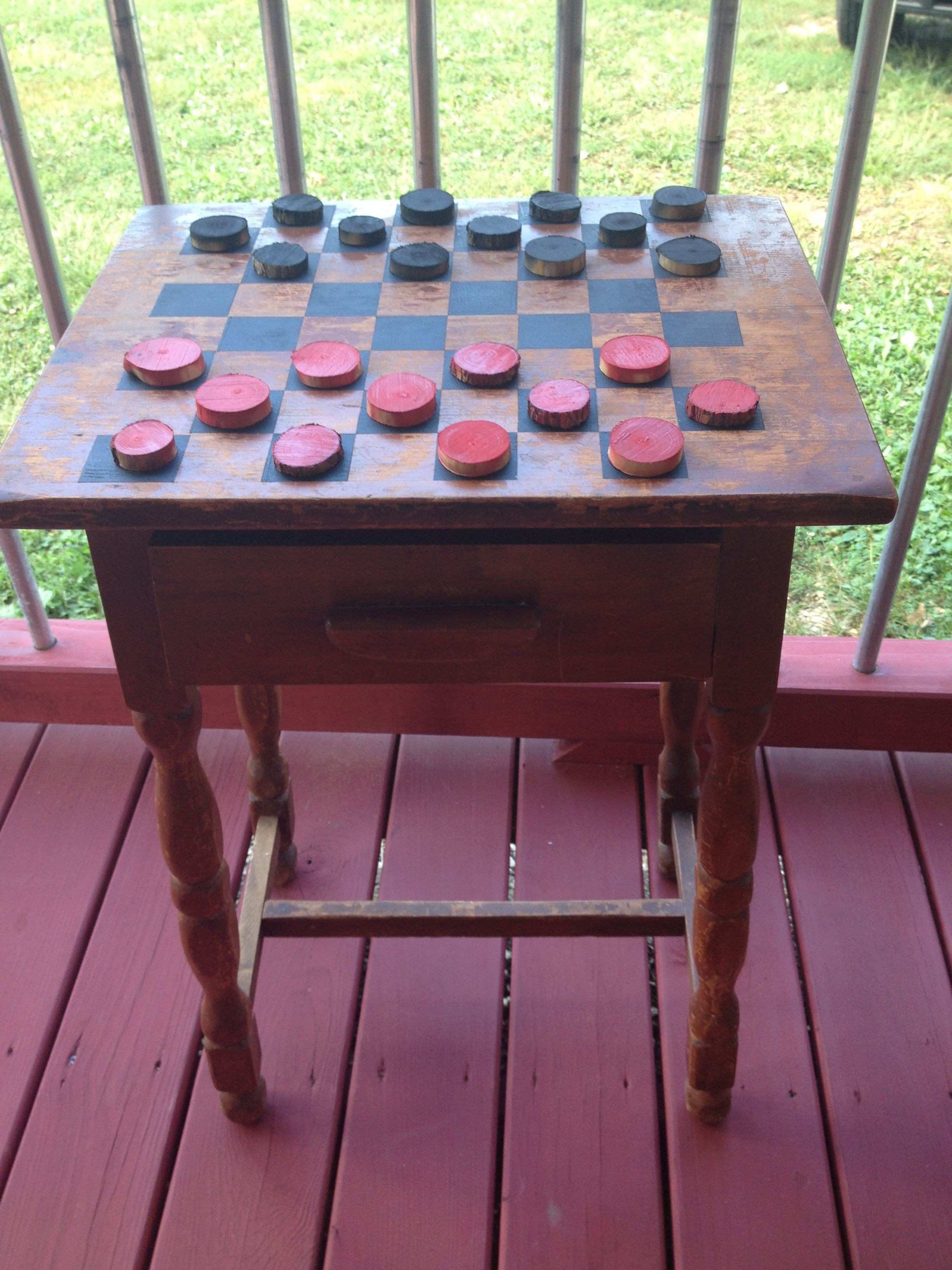 Outdoor checker table made from an old distressed end table Checker