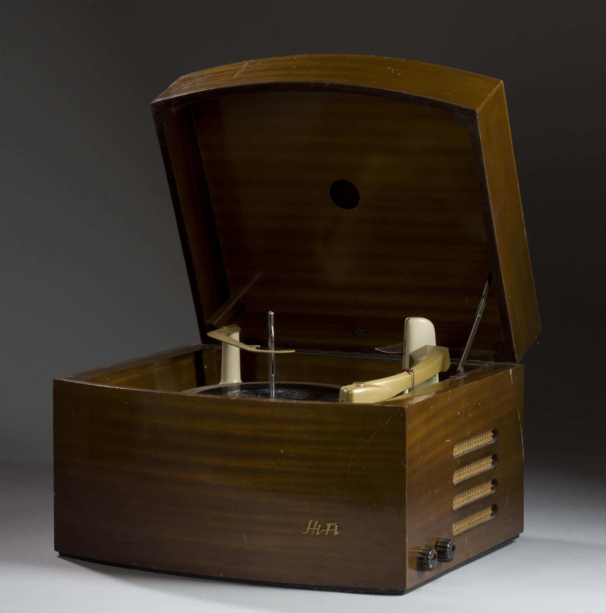 Mains operated record player in a polished wooden cabinet made by